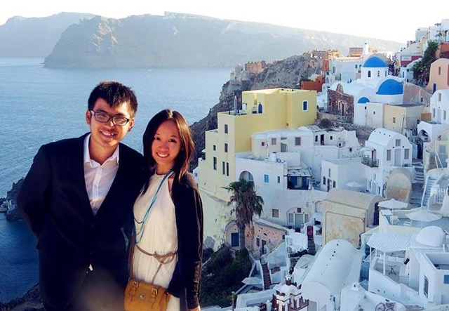 It was his (Anthony's) graduation trip. Santorini, Greece seems to be a popular venue for wedding parties. A bridesmaid helped us to take this photo - by Vivian IG: littlemisshappyfeet - MissMaps.com Featured Female Traveler