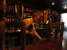 Bartending at McGinnis - Belfast, North Ireland- by Anika Mikkelson - Miss Maps - www.MissMaps.com