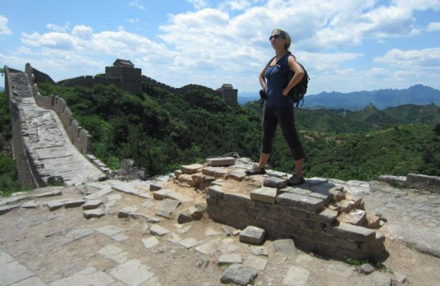 Erica Hobbs Hiking the Great Wall of China - MissMaps.com Featured Female Traveler