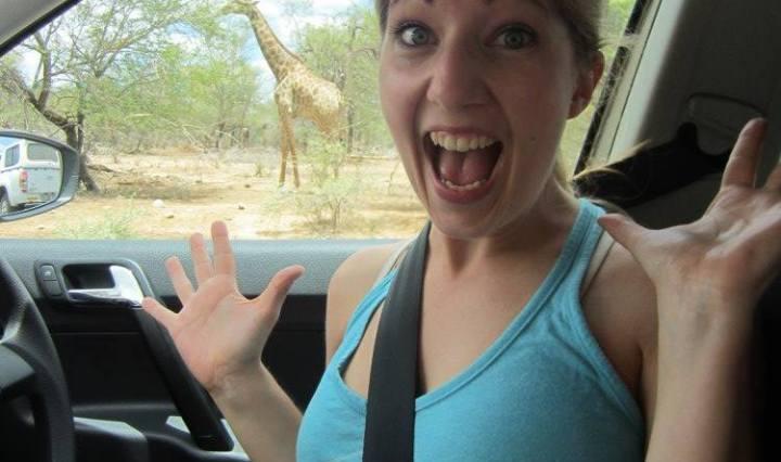 Erica Hobbs seeing giraffes on safari at Kruger National Park in South Africa - MissMaps.com Featured Female Traveler