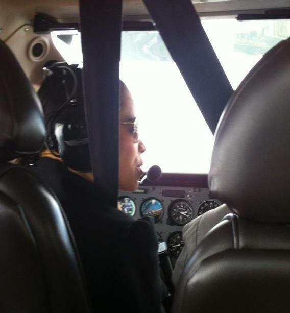 How's that for adventure - Jelitsa in the cockpit - MissMaps.com Featured Female Traveler