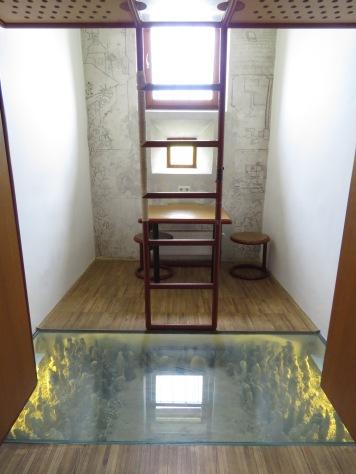 In floor statues - Hotel Celiac Ljubljana Slovania - by Anika Mikkelson - Miss Maps - www.MissMaps.com