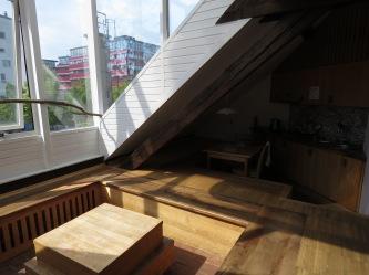 The main living room and kitchen of Hotel Celiac Ljubljana Slovania - by Anika Mikkelson - Miss Maps - www.MissMaps.com