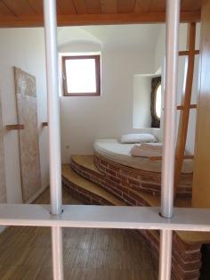 Wedged in the jail cell - Hotel Celiac Ljubljana Slovania - by Anika Mikkelson - Miss Maps - www.MissMaps.com
