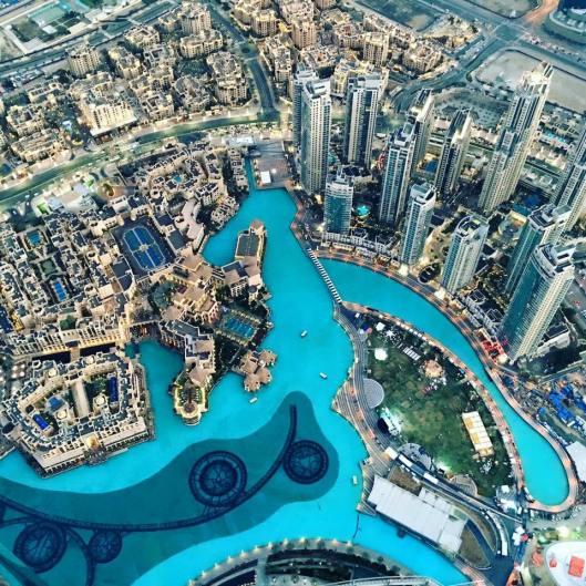 Dubai- from the top of the Burj Khalifa - over 1,800+ feet in the air - by Nicole Sunderland - MissMaps.com Featured Female Traveler