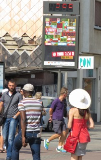 It was hard to catch - The sign shows 39 degrees! It was HOT in Bratislava Slovakia - by Anika Mikkelson - Miss Maps - www.MissMaps.com