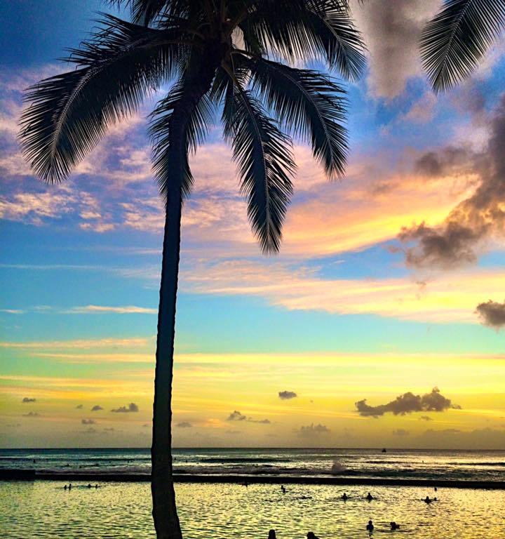Sunset taken on Waikiki Beach, Oahu- by Nicole Sunderland - MissMaps.com Featured Female Traveler