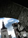 A Church Steeple through a stone archway - Tallinn Estonia - by Anika Mikkelson - Miss Maps - www.MissMaps.com