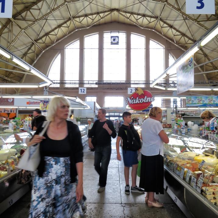 Cheese shops aplenty at the market - Riga Latvia - by Anika Mikkelson - Miss Maps - www.MissMaps.com