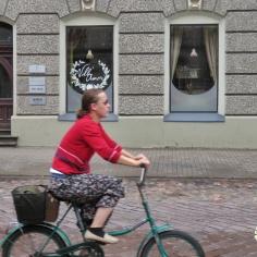 Colorful Cyclist - Riga Latvia - by Anika Mikkelson - Miss Maps - www.MissMaps.com