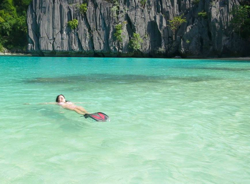 Courtney at a lagoon just off the coast of El Nido, Philippines - www.MissMaps.com Featured Female Traveler
