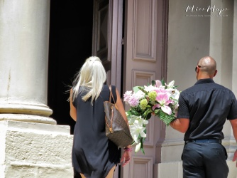 Entering Msida Parish with flowers for a funeral - Malta - by Anika Mikkelson - Miss Maps - www.MissMaps.com