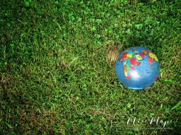 Even the dog likes maps - notice all the teeth marks on his ball - Northern Estonia - by Anika Mikkelson - Miss Maps - www.MissMaps.com