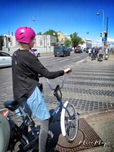Helsinki Scavenger Hunt: Cyclists Wearing Helmets - Helsinki Finland - by Anika Mikkelson - Miss Maps - www.MissMaps.com