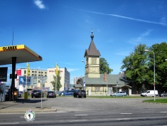 Immanuel Pentecostal Parish from the 18th century sits between new modern ammenities - Tallinn Estonia - by Anika Mikkelson - Miss Maps - www.MissMaps.com