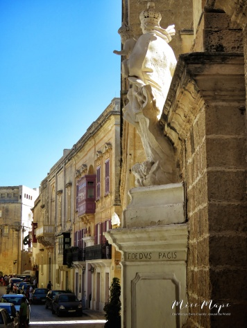 Statue outside Carmelite Church and Streets of Mdina - Malta - by Anika Mikkelson - Miss Maps - www.MissMaps.com