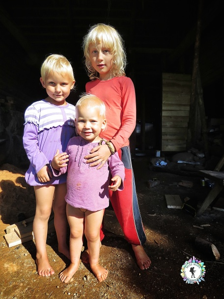 The three children playing in the barn - South Estonia - by Anika Mikkelson - Miss Maps - www.MissMaps.com