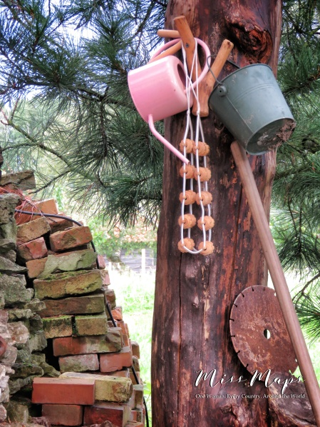 Waiting for a warm day - buckets on a wooden post - Northern Estonia - by Anika Mikkelson - Miss Maps - www.MissMaps.com