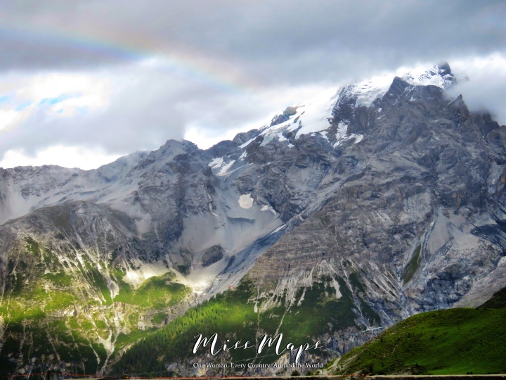 A Rainbow Appeared at the Mountainous Border Crossing Between Italy Switzerland and Austria - The Road to Liechtenstein - by Anika Mikkelson - Miss Maps - www.MissMaps.com