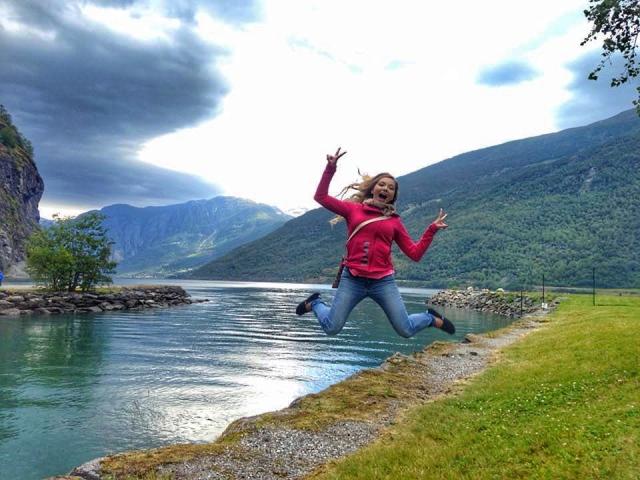 Kyla Wanderlust jumping for joy at the Algarve - MissMaps.com Featured Female Traveler