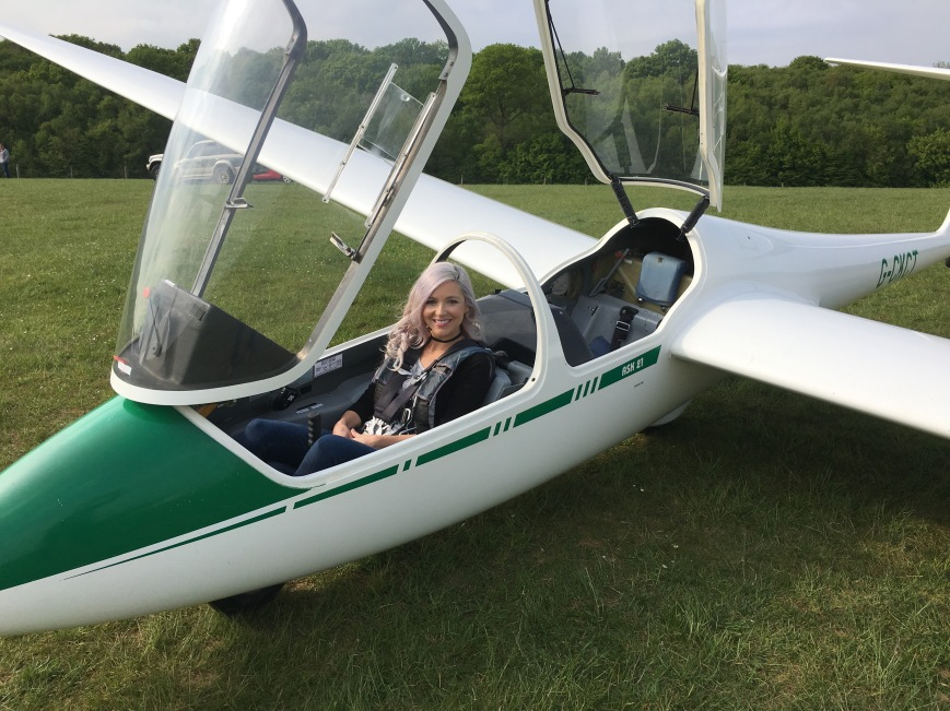 Kyla Wanderlust gliding in England - MissMaps.com Featured Female Traveler