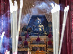 Burning Incense at Buddhist Temple - Bangkok Thailand - by Anika Mikkelson - Miss Maps - www.MissMaps.com
