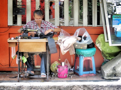 Sewing on the Street - Bangkok Thailand - by Anika Mikkelson - Miss Maps - www.MissMaps.com