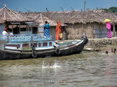 Boys Playing in the River - Sundarbans Near Mongla Bangladesh - by Anika Mikkelson - Miss Maps - www.MissMaps.com