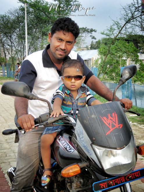Father and Son on a Motorcycle - Mongla Bangladesh - by Anika Mikkelson - Miss Maps - www.MissMaps.com