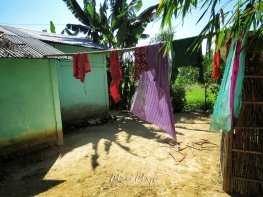 Colorful Clothesline at the Tea Garden - Sylhet Bangladesh - by Anika Mikkelson - Miss Maps - www.MissMaps.com