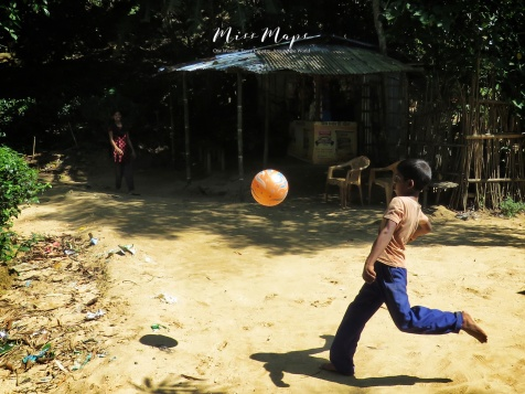 Boy Playing Kickball at the Tea Garden - Sylhet Bangladesh - by Anika Mikkelson - Miss Maps - www.MissMaps.com