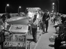 Vendors on the Main Bridge at Night - Sylhet Bangladesh - by Anika Mikkelson - Miss Maps - www.MissMaps.com