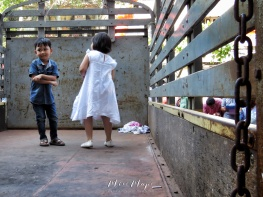 Boy and Girl Dancing in a Truck to Chinese Music - Chinese New Year - Chinatown - Yangon Myanmar - by Anika Mikkelson - Miss Maps - www.MissMaps.com