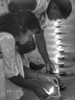 Lighting Candles at the Buddhist Temple on New Years Day - Galle Sri Lanka - by Anika Mikkelson - Miss Maps - www.MissMaps.com