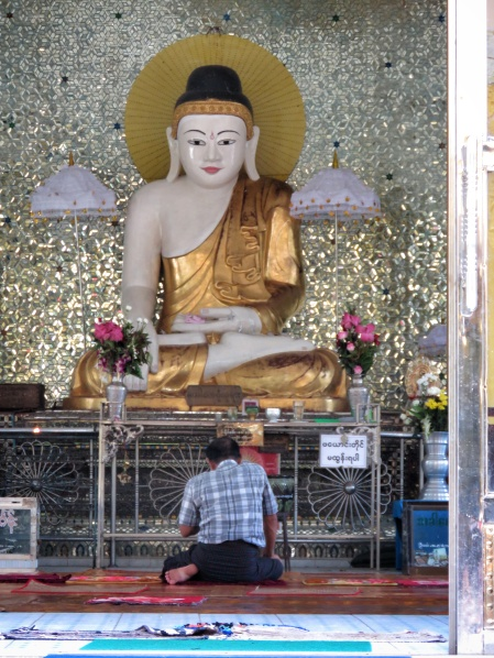 Man Praying Before Tara - Female Buddha - Shwemawdaw Pagoda - Pagu Bago Myanmar - by Anika Mikkelson - Miss Maps - www.MissMaps.com