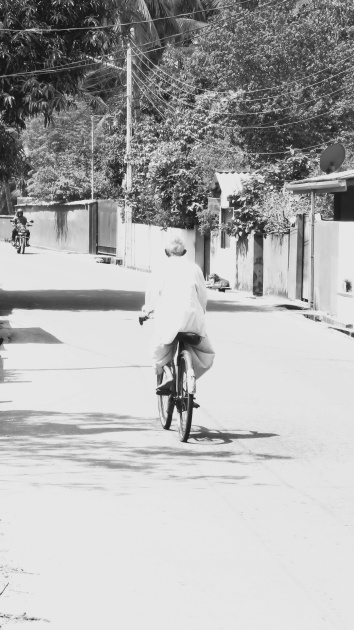 man-riding-his-bicycle-galle-sri-lanka-in-black-and-white-by-anika-mikkelson-miss-maps-www-missmaps-com