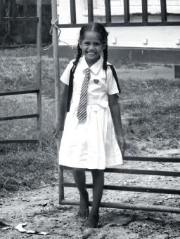 A beautiful smiling schoolgirl - Galle Sri Lanka - by Anika Mikkelson - Miss Maps - www.MissMaps.com
