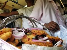 Traditional Snacks for Sale - Views from the Train - Train Ride Ella to Kandy Sri Lanka - by Anika Mikkelson - Miss Maps - www.MissMaps.com