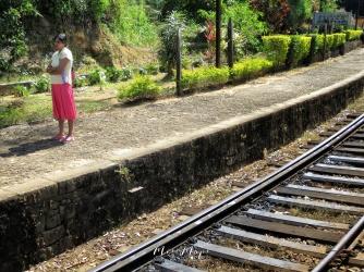 Woman Waiting for the Train - Views from the Train - Train Ride Ella to Kandy Sri Lanka - by Anika Mikkelson - Miss Maps - www.MissMaps.com