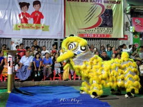 Yellow Lion Dancers Preparing to begin the competition - Chinese New Year - Chinatown - Yangon Myanmar - by Anika Mikkelson - Miss Maps - www.MissMaps.com