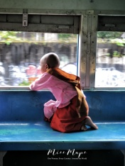 Young Nun Enjoying the View from the Train - by Anika Mikkelson - Miss Maps - www.MissMaps.com
