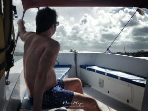 Boat Boy - Ile aux Cerfs - Mauritius - by Anika Mikkelson - Miss Maps - www.MissMaps.com