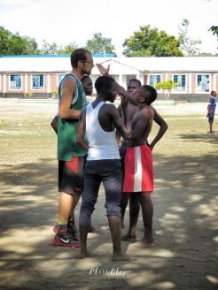 Boys Arguing with Coach Luca - Rusinga Island Kenya - by Anika Mikkelson - Miss Maps - www.MissMaps.com