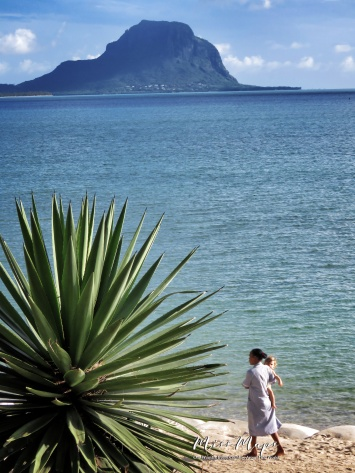 Down by the Sea - a baby and helper - Mauritius - by Anika Mikkelson - Miss Maps - www.MissMaps.com