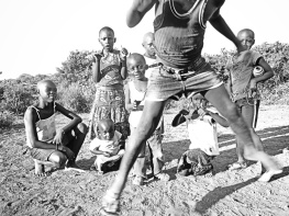 Jumping Boy and Thumbs Up in Black and White - Rusinga Island Kenya - by Anika Mikkelson - Miss Maps - www.MissMaps.com