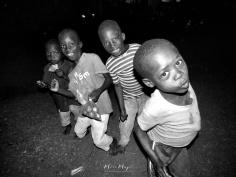 Dancing School Boys in Black and White 1 - Rucinga Island Kenya - by Anika Mikkelson - Miss Maps - www.MissMaps.com