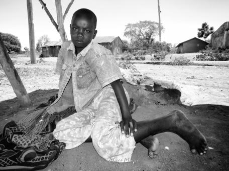 Girl Selling Anchovies -in Black and White - Rucinga Island Kenya - by Anika Mikkelson - Miss Maps - www.MissMaps.com
