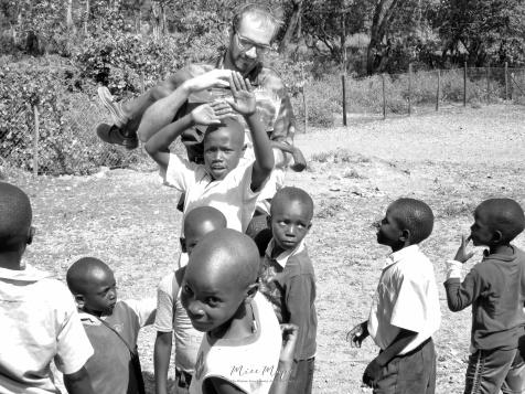Luca with School Boys in Black and White 1 - Rucinga Island Kenya - by Anika Mikkelson - Miss Maps - www.MissMaps.com