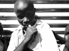 School Boy in Black and White 1 - Rucinga Island Kenya - by Anika Mikkelson - Miss Maps - www.MissMaps.com