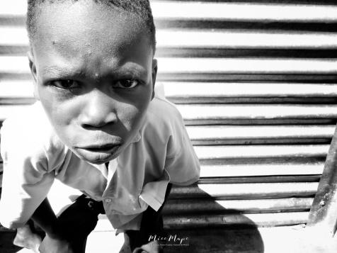 School Boy in Black and White 2 - Rucinga Island Kenya - by Anika Mikkelson - Miss Maps - www.MissMaps.com